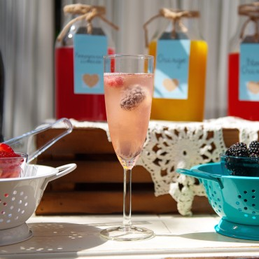 Refreshing summer mimosa bar for a theme bridal shower brunch.
