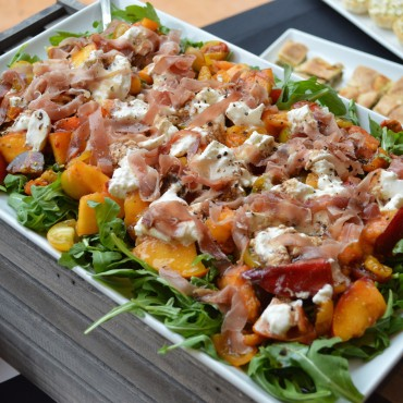 Creative appetizers – like this peach salad – make a perfect pairing to summer soiree.